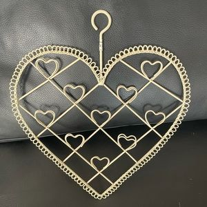 Cute wall decor to hold bills or jewellery.